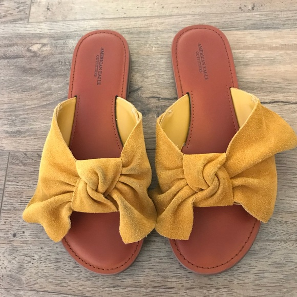 91c7d10b9 American Eagle Outfitters Shoes | Yellow Suede Bow Slides | Poshmark